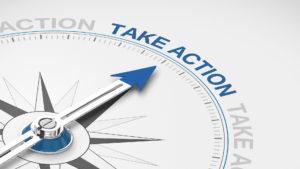 """Kompassnadel die auf """"Take Action"""" zeigt"""